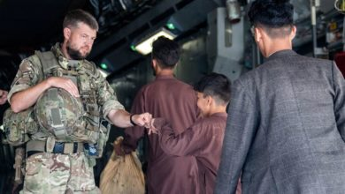 Afghan families get on a UK flight out of Kabul