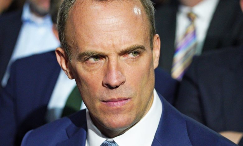 Lord Chancellor Dominic Raab awaits Prime Minister Boris Johnson's keynote speech at the Conservative Party Conference in Manchester. Picture date: Wednesday October 6, 2021.