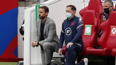 Gareth Southgate's men take the knee before every match (pictured) to highlight racism but migrant workers building World Cup stadiums in Qatar have died in their hundreds and are treated as 'staves'